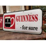 Guinness For Sure advertising sign.