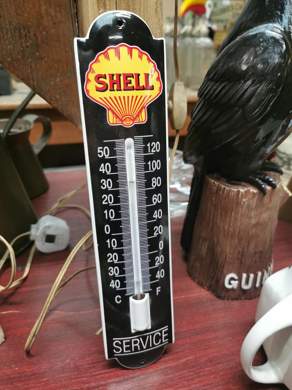 Shell Service barometer advertising sign.