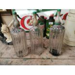 Three Thwaites glass soda siphons.