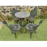 Decorative cast iron garden table and four chairs.
