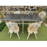 Cast iron table and four chairs.