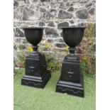 Pair of good quality cast iron urns.