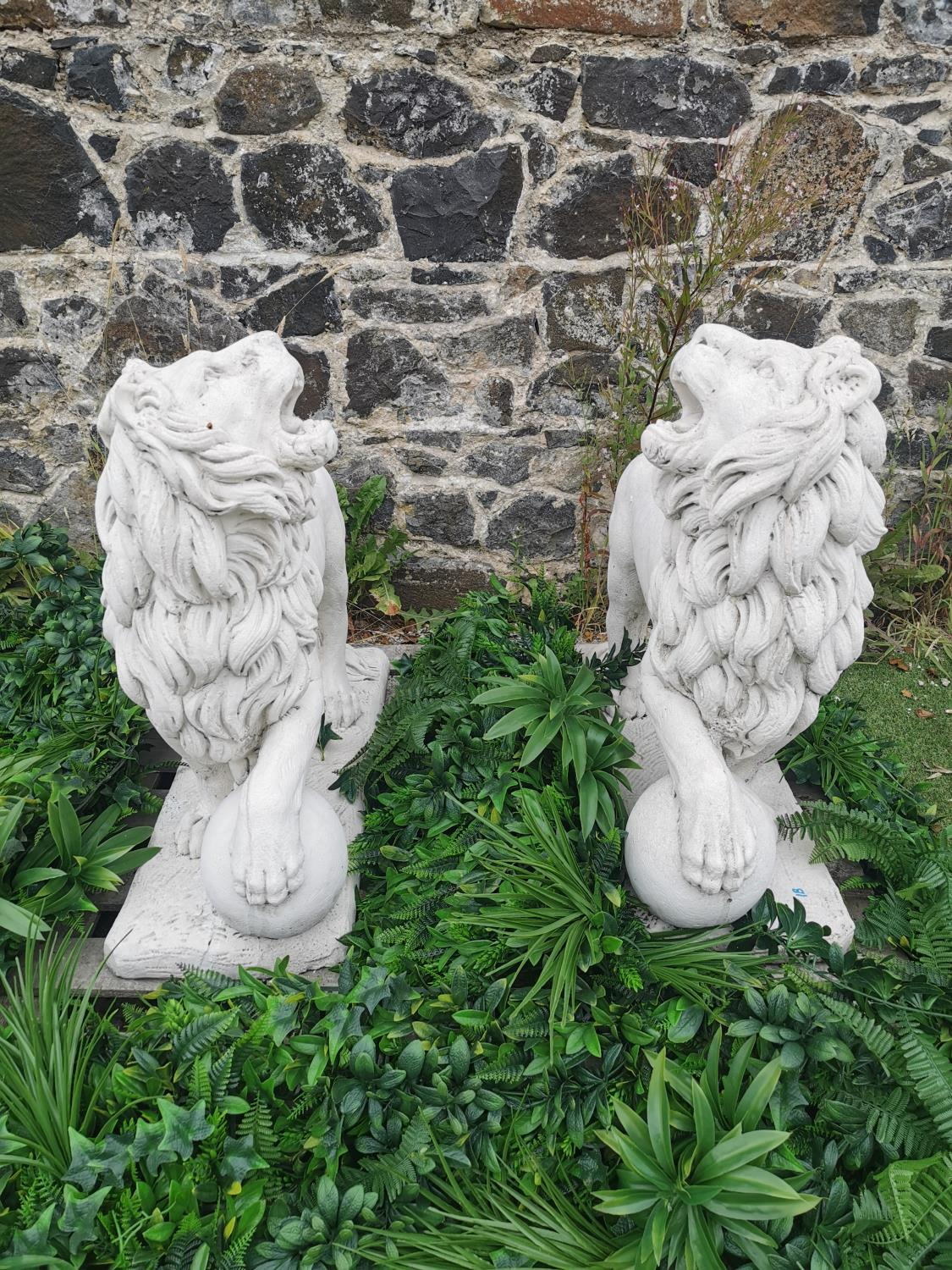 Pair of moulded stone models of Lions.