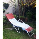 Retro metal garden recliner.