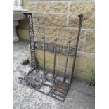 Decorative cast iron boot rack and foot scrapper.
