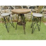 Metal high garden swivel table and two high stools.