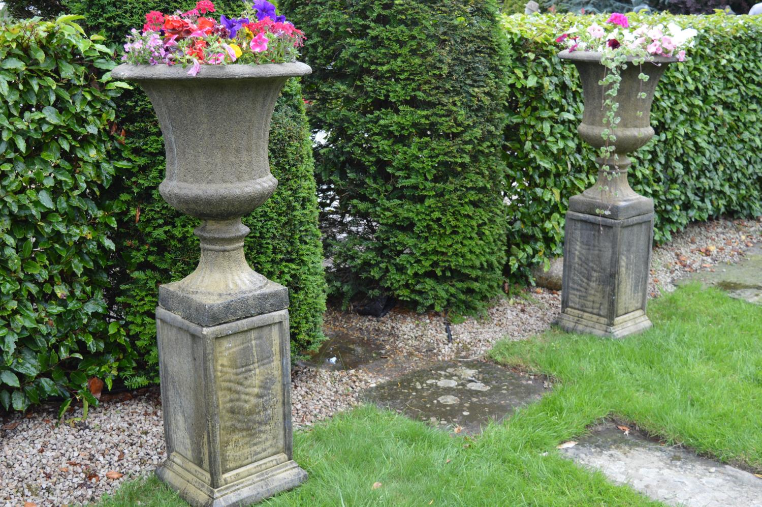 Pair of stone fluted urns