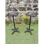 Pair of decorative cast iron tractor seat bar stools.
