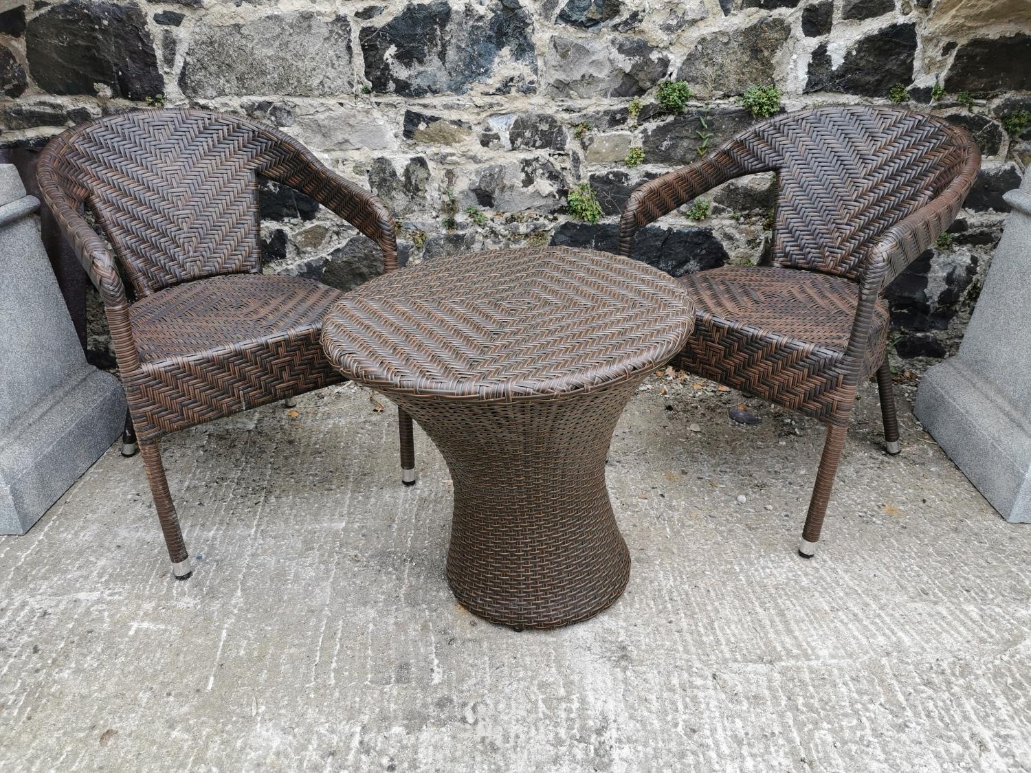 Rattan garden table and two chairs.