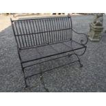 Decorative wrought iron garden bench