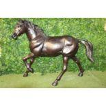 Bronze model of a trotting Horse.