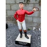 Cast iron James Brown Saddlery statue