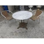 Cast iron garden table and two chairs.
