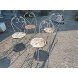 Set of four wrought iron garden chairs
