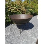 Wrought iron fire pit on stand