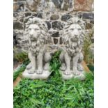 Pair of moulded stone seated Lions.