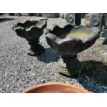 Pair of composition urns.