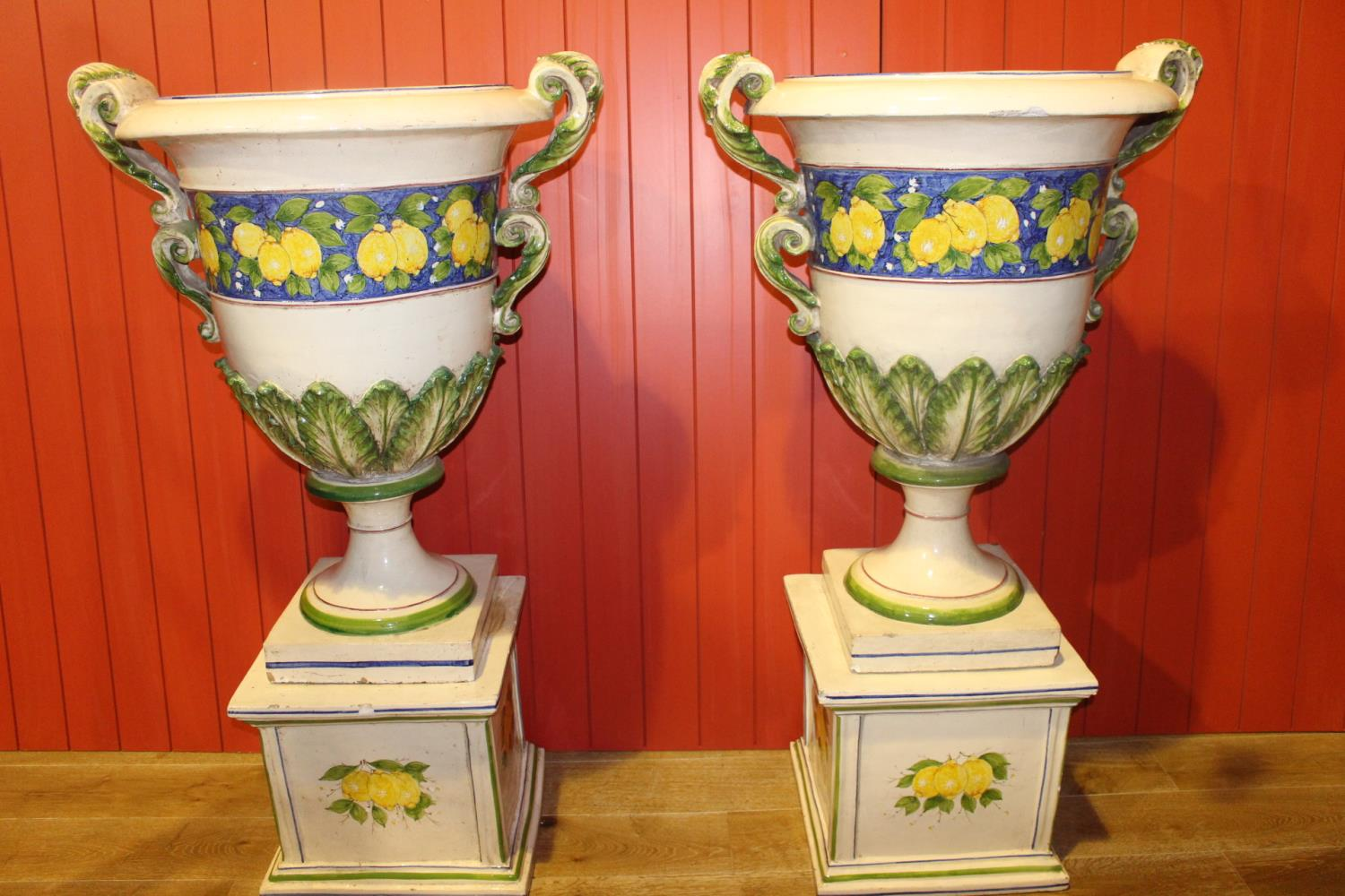 Pair of Italian Cecarelli hand painted urns on base.