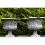 Pair of decorative sandstone urns