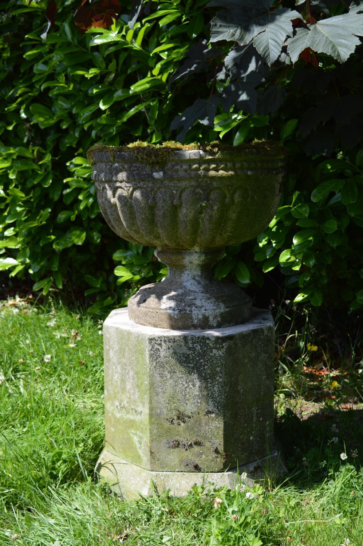 Stone urn on hexagon pedestal