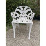 Decorative cast iron fern leaf garden chair.