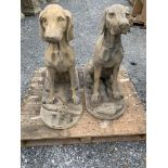 Pair of composite seated dogs.