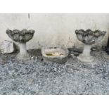 Pair of moulded stone urns.