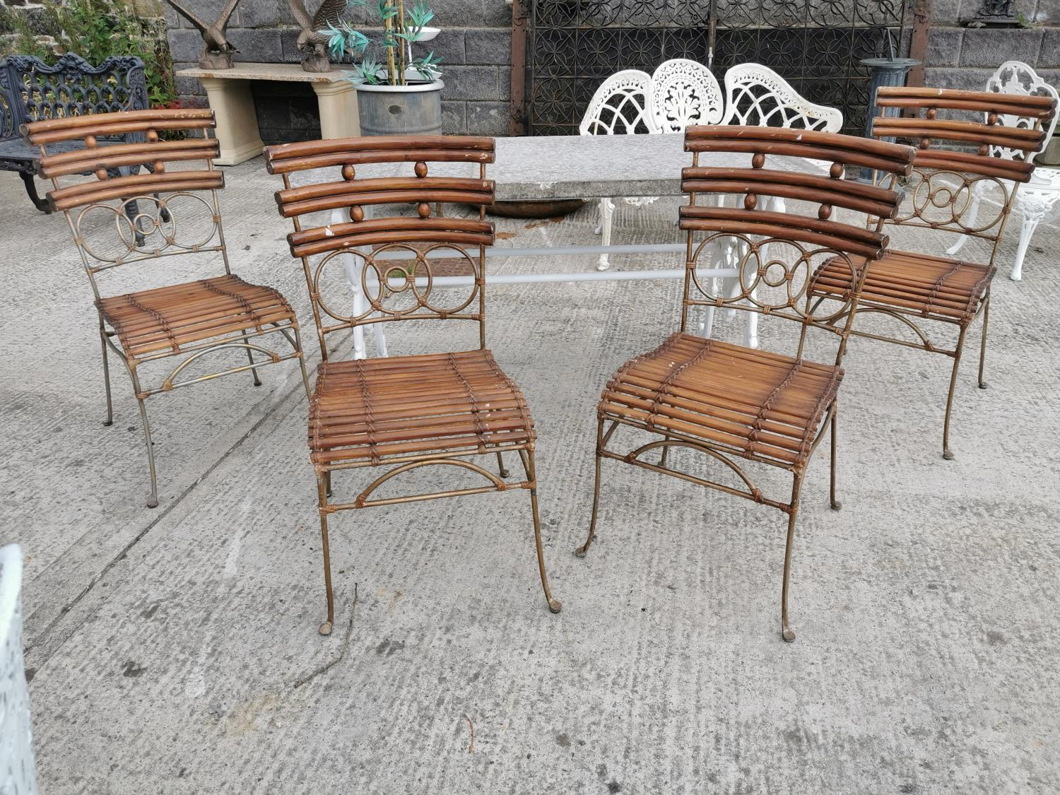 Set of four wrought iron and bamboo garden chairs.