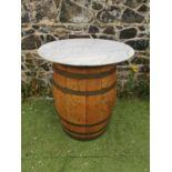 Oak metal bound whiskey barrel table.