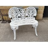 Decorative cast alloy two seater garden bench.