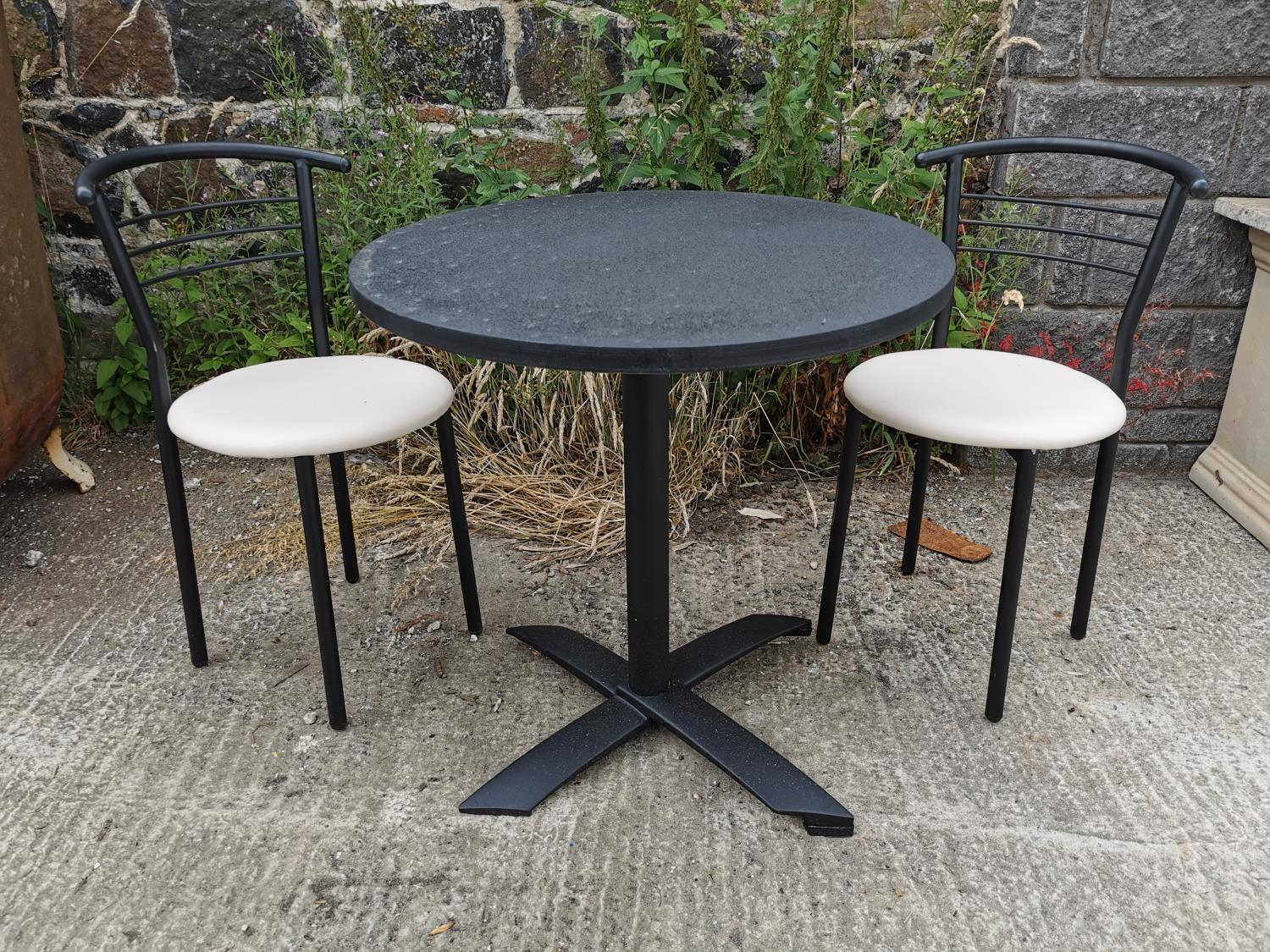 Round café table and two chairs.