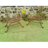 Pair of wrought iron garden stools.