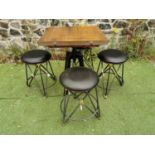 Wrought iron garden table and four stools.