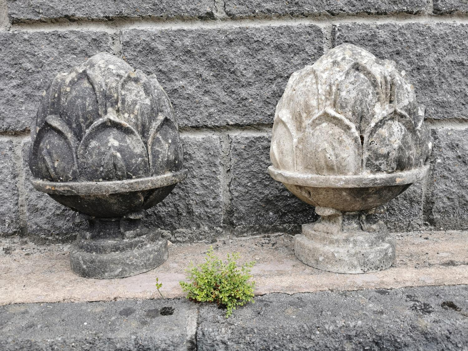 Pair of polystone finials in the form of acorns.