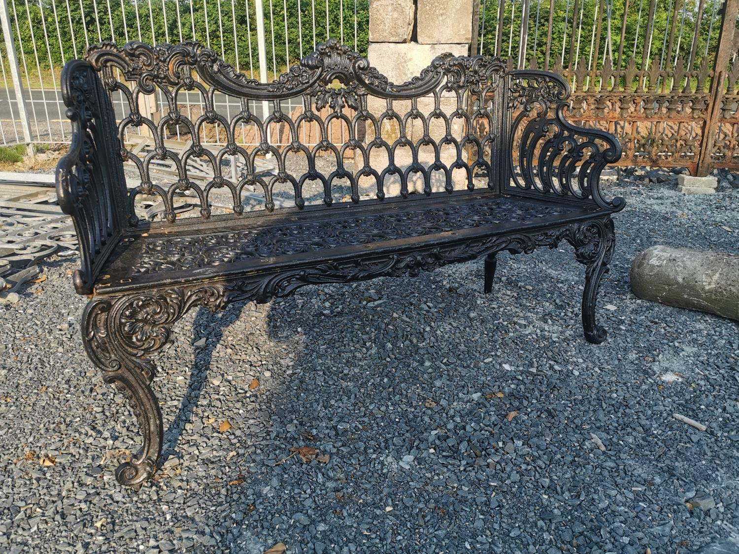 Decorative cast iron garden bench in the Rococo style