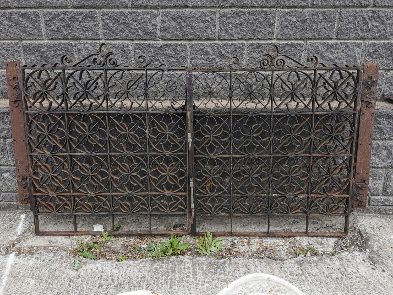 Set of wrought iron entrance gates with brackets.