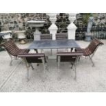 Good quality cast iron garden table and six chairs.