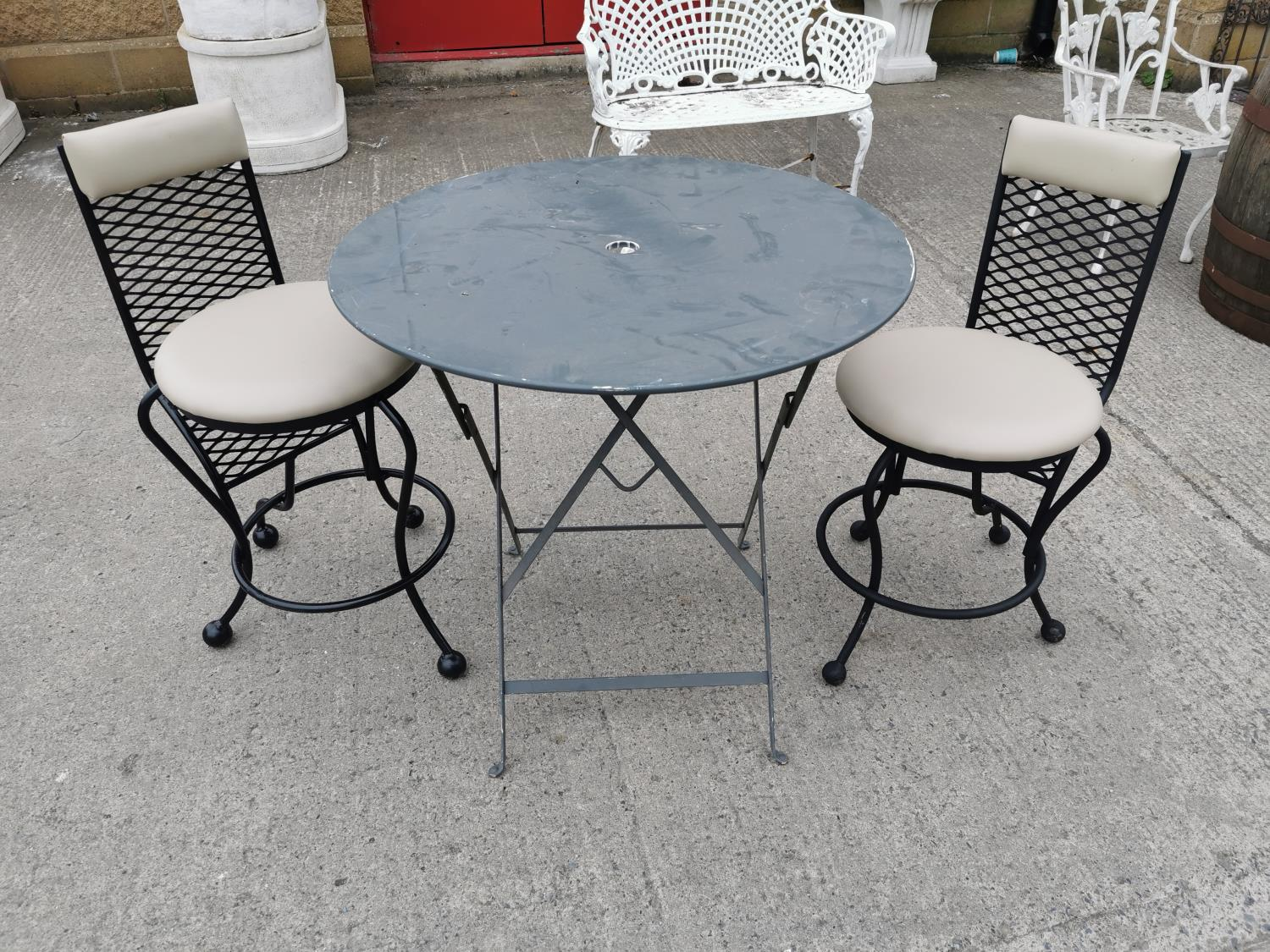 Wrought iron garden table and two chairs.