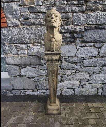 Composite bust of Salvador Dali on plinth