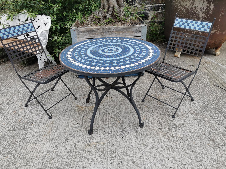 Wrought iron and mosaic three piece garden set.