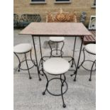 Wrought iron high garden table and four stools.