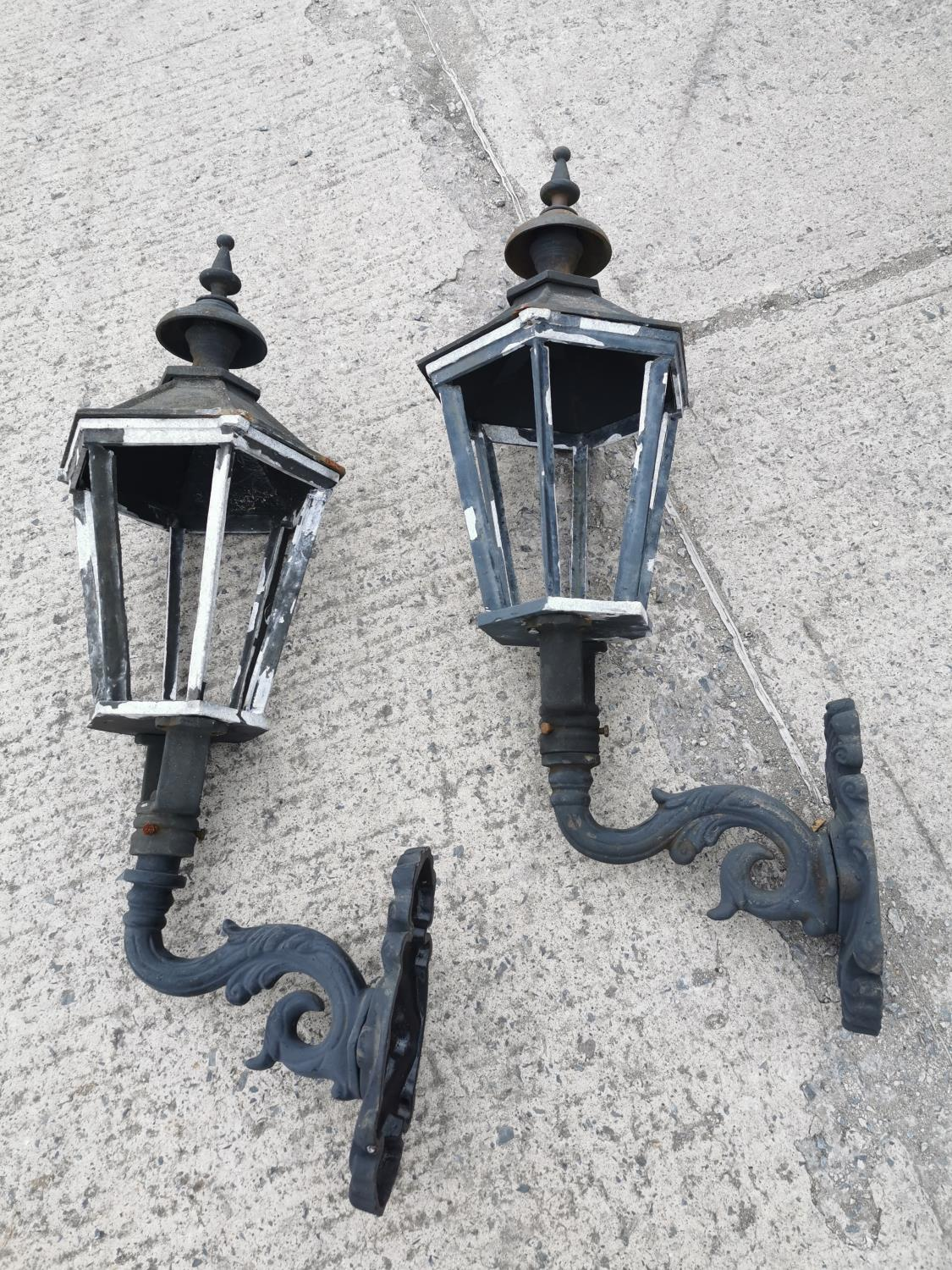 Pair of cast iron and alloy wall lights.