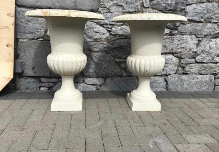 Large pair of cast iron urns
