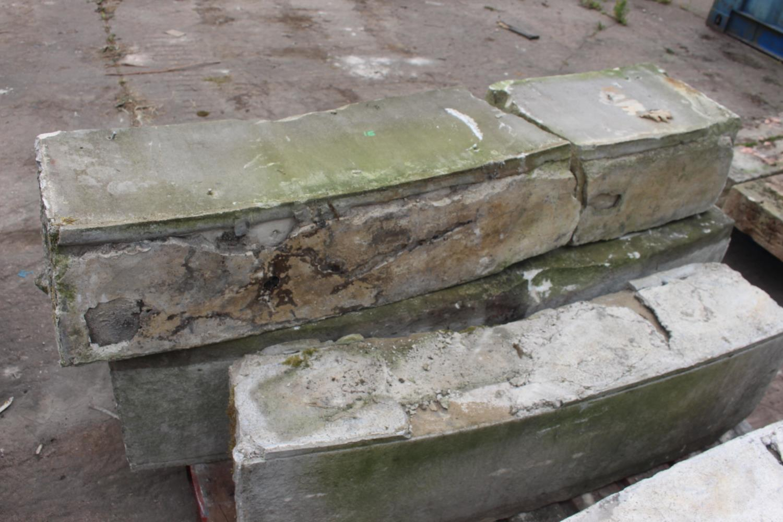 Pallet of four curved sandstone blocks