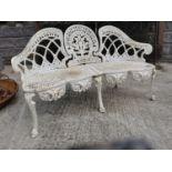 Cast iron three seater garden bench.