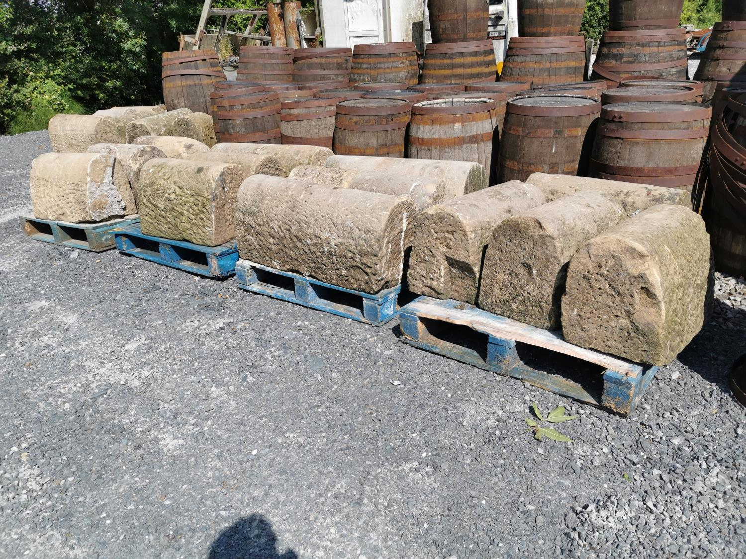 Fifteen pieces of sandstone wall capping.