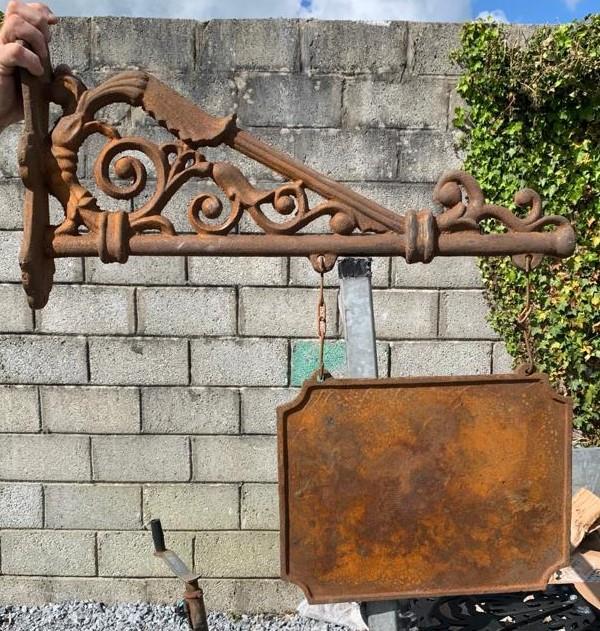 Cast iron shop sign