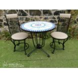 Wrought iron garden table and two stools.