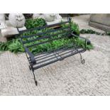 Wrought iron child's garden bench.