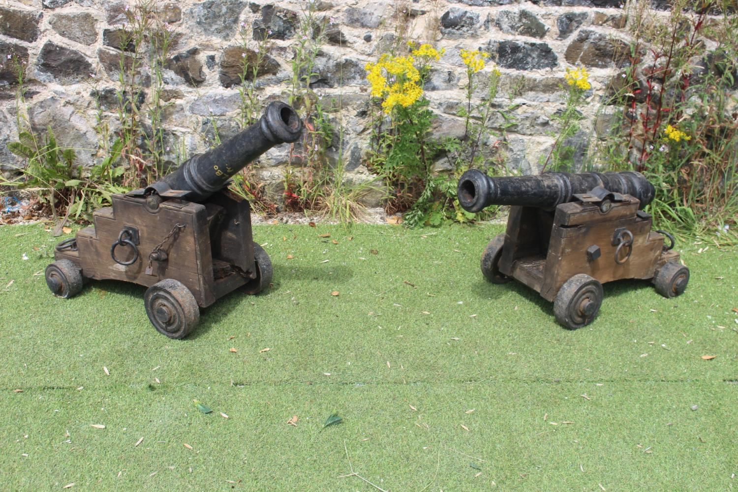 Pair of cast iron and wooden cannons